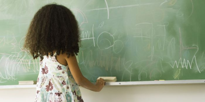 landscape-1462288469-girl-at-chalkboard